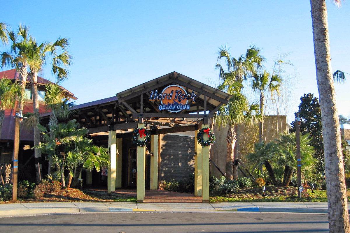 The Hard Rock Beach Club Choctaw, with open-air architecture and Christmas wreathes on the posts before the entry.