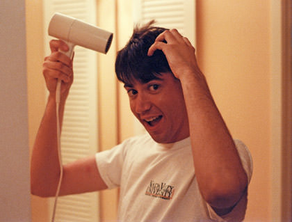 Dave drying his hair with a hair dryer, back when he had lots of hair.