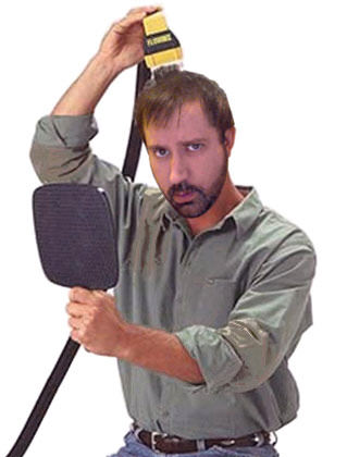 Dave Photoshopped to be using a Flowbee hair cutter.