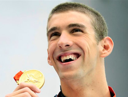 Michael Phelps and his gold medal.