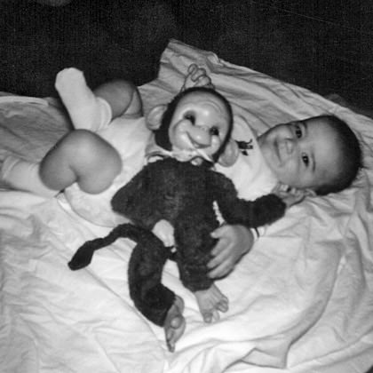 Baby Dave with a Stuffed Monkey Toy