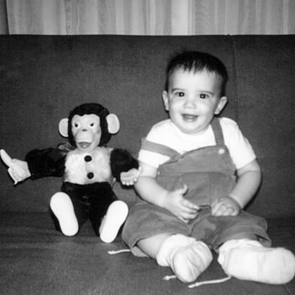 Baby Dave with a Different Stuffed Monkey Toy