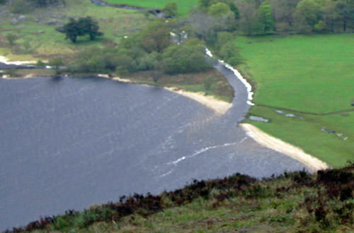 A photo of Lough Tay's white sand beach.