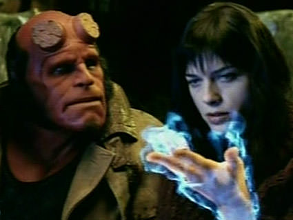 Selma Blair as Liz with fire on her hand in Hellboy