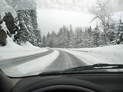 Me driving on a very snowy road.
