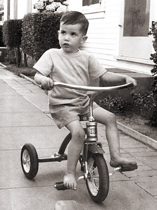 Me when I was very young riding a tricycle.