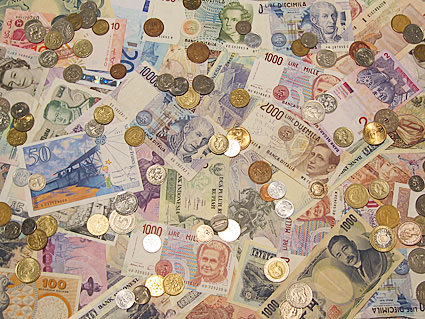 A photo of a bunch of foreign currency scattered on a table.