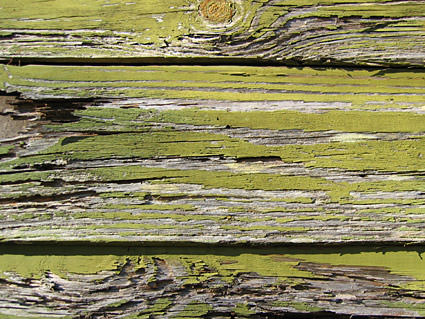 Green-painted wood that's been badly weathered.