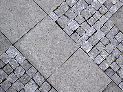 Concrete tiles in a sidewalk.