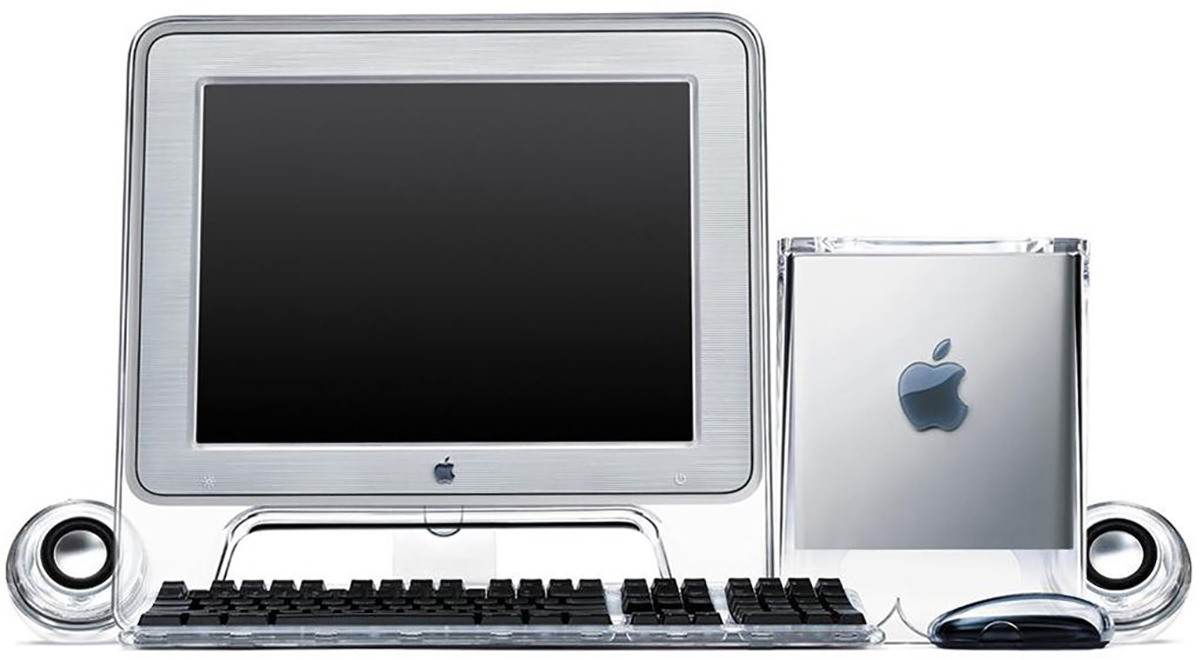 The Macintosh G4 Cube computer next to a matching monitor and keyboard.