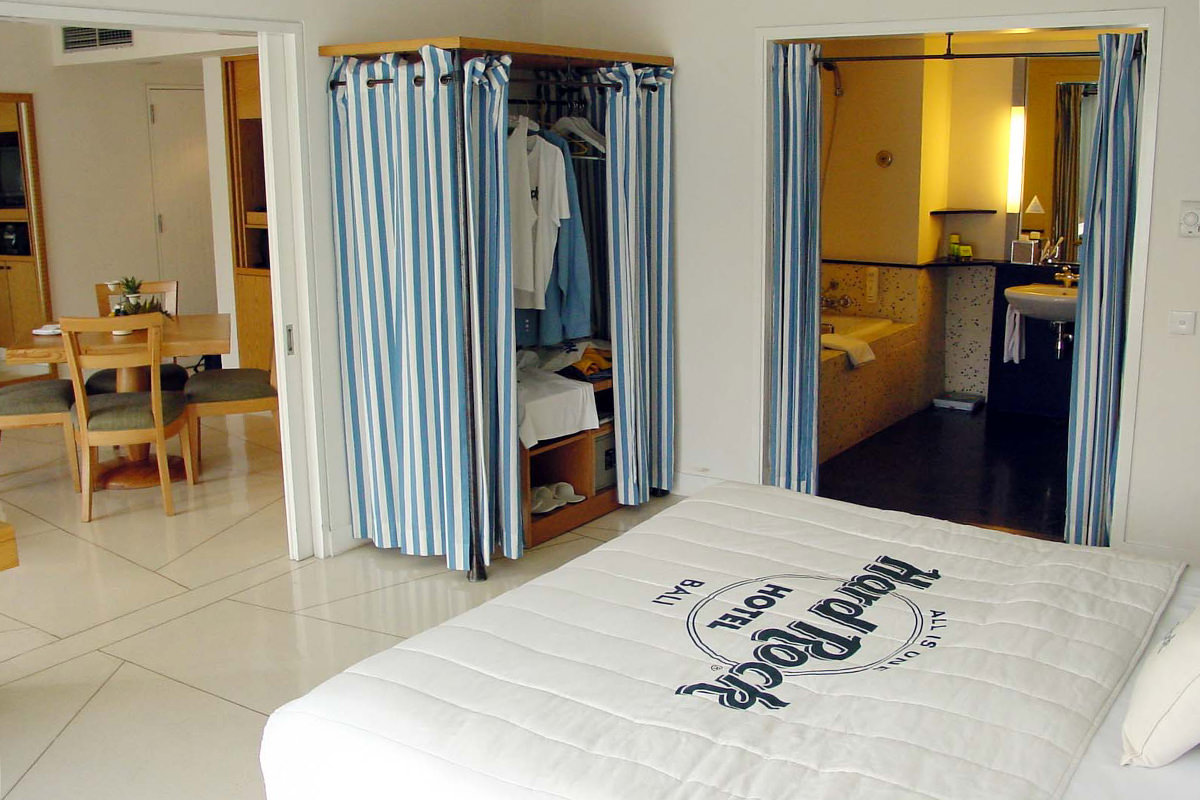 My Room at the Hard Rock Hotel in Bali which has light, airy colors and pretty wood furnishings.
