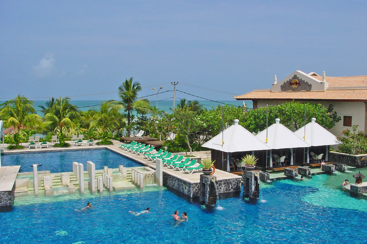 Another image of a pool with cabanas from the Hard Rock Hotel in Bali.