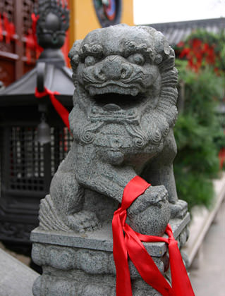 Red Ribbon on a Stone Lion