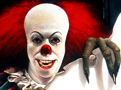 Tim Curry as Pennywise in IT