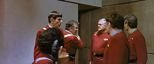 Captain Kirk tells Scotty to check out the back.