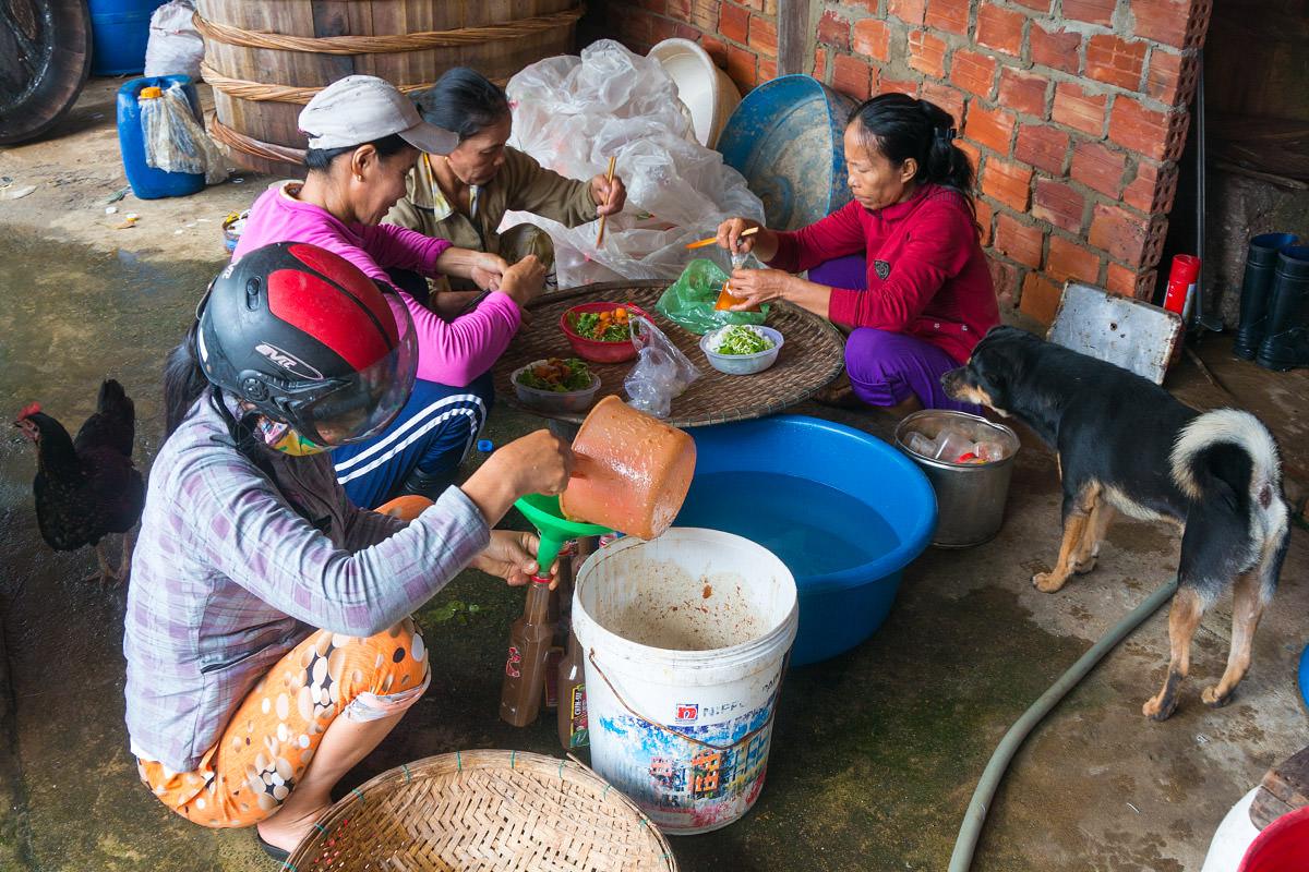 Fish Sauce Workers Having Lunch in Vietnam
