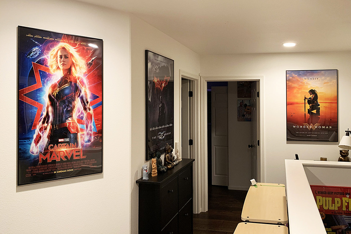 Captain Marvel and Wonder Woman hanging in my hallway