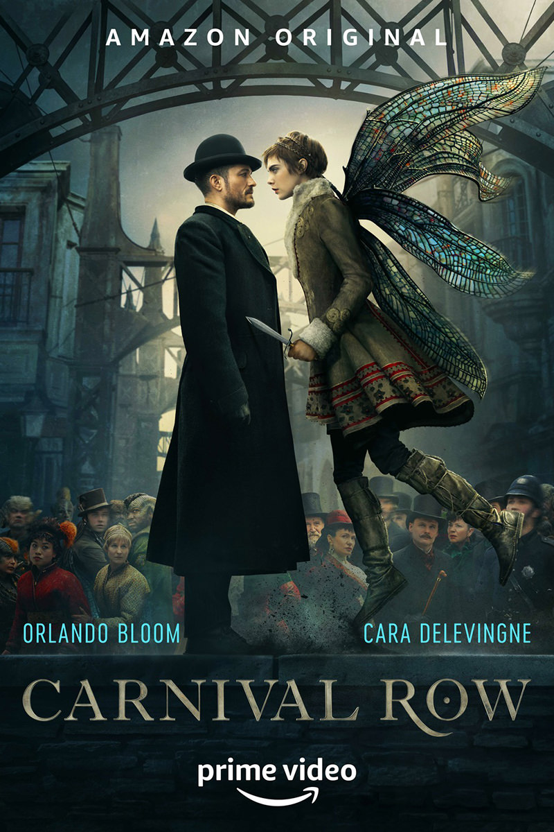 A poster for Carnival Row showing an industrial Victorian background with Orlando Bloom in formal wear being confronted by a woman with dragonfly wings hovering before him.