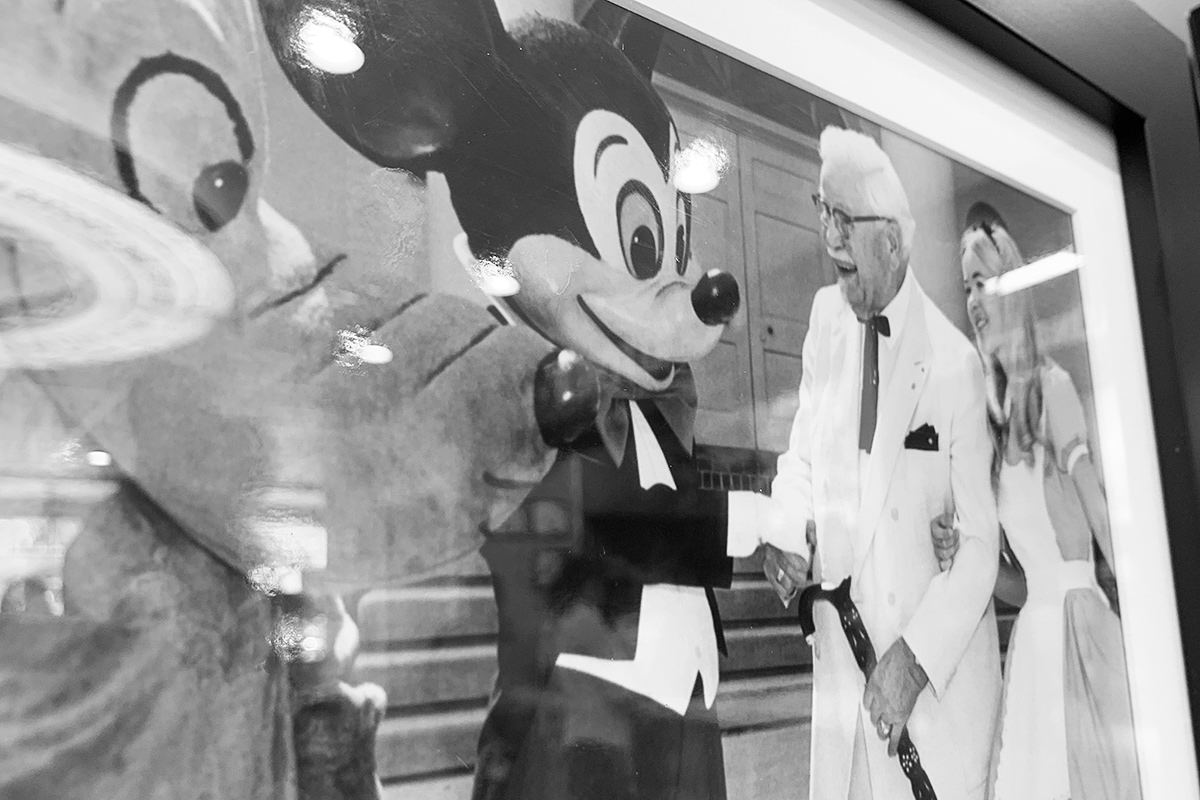 Colonel Sanders meets Mickey Mouse in an old photo at KFC!