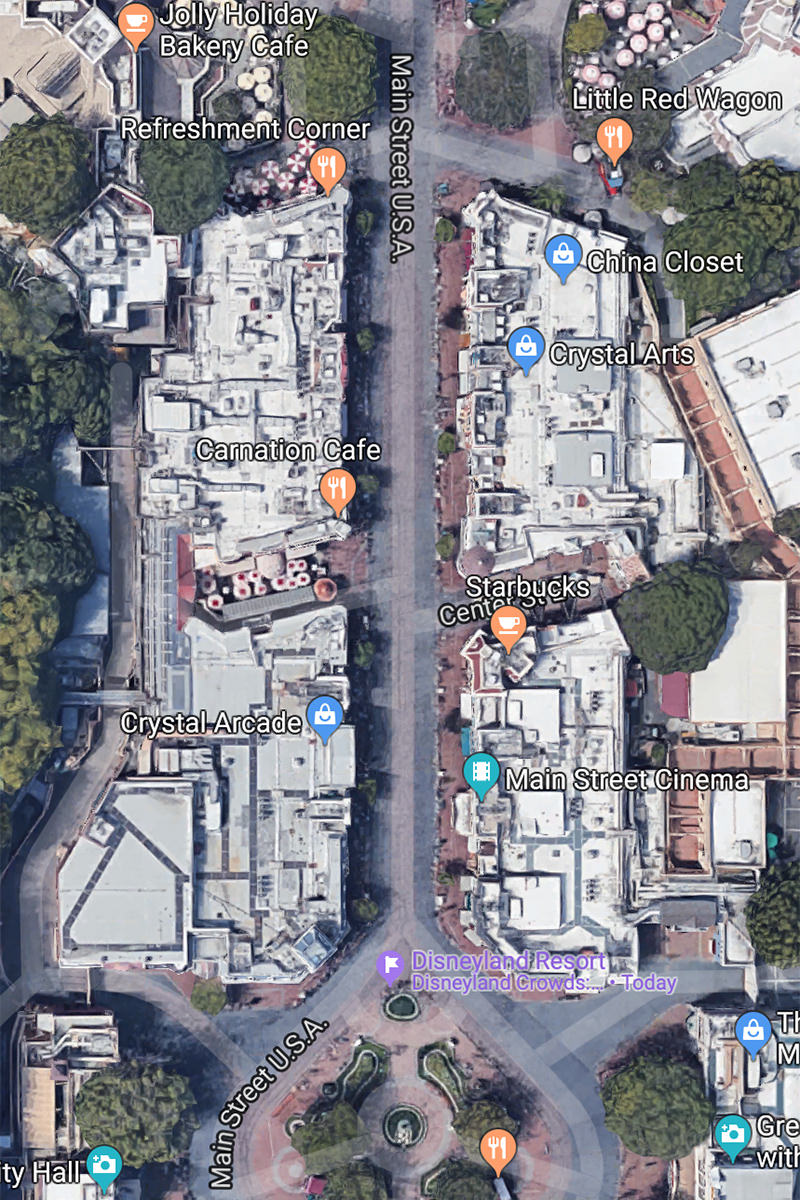 An aerial view of Disneyland's Main Street showing how all the buildings are under two big roofs.