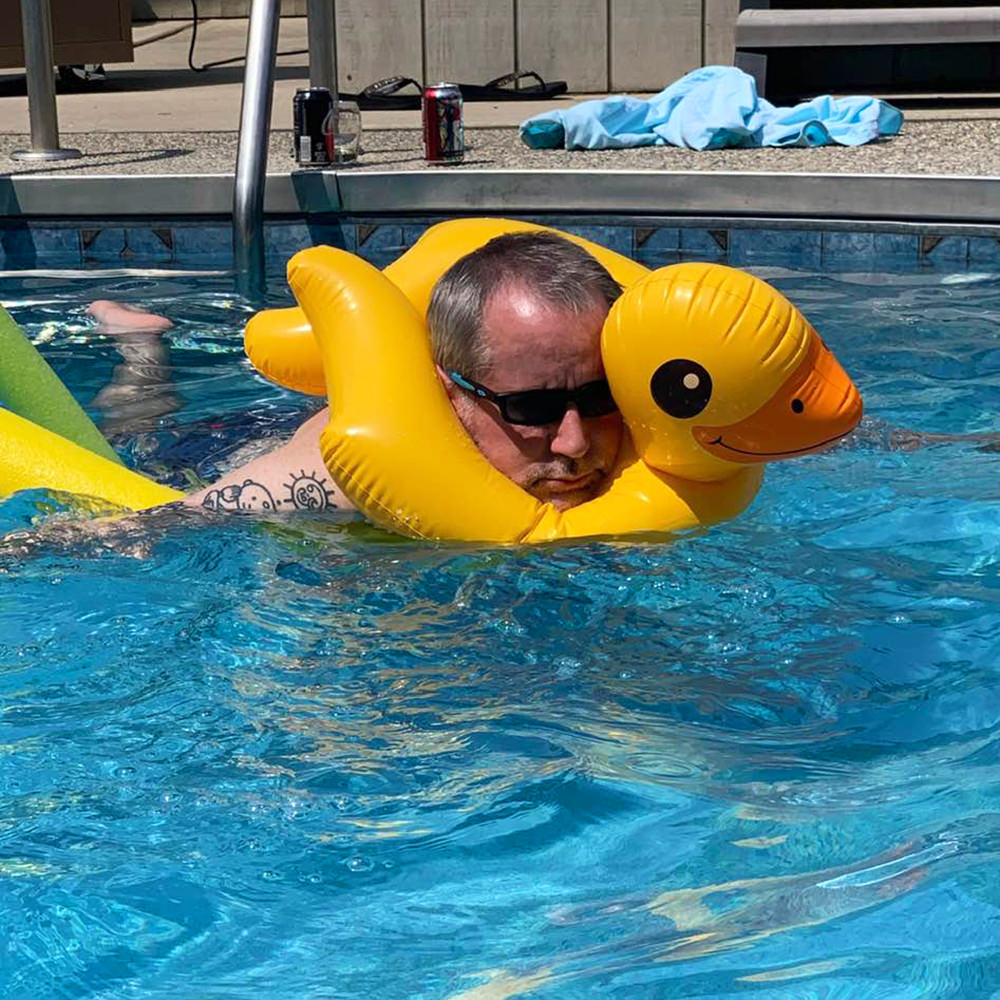 Dave in a Pool with a Duck Floaty