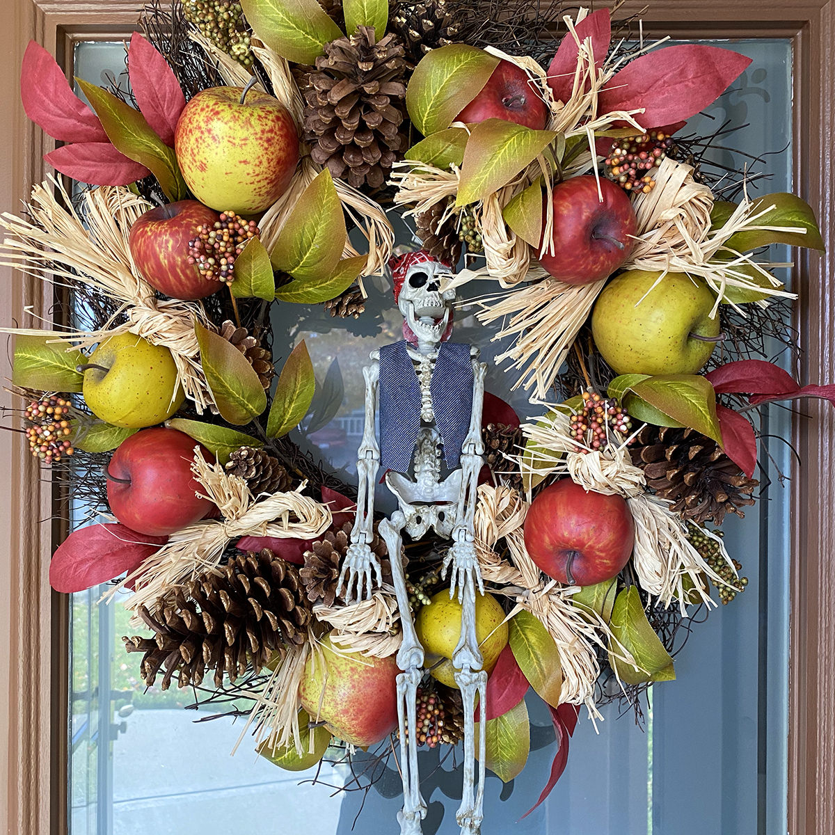 A wreath on my door filled with fake apples, real pinecones, and other Fall-apropriate stuff... with a pirate skeleton in the middle.