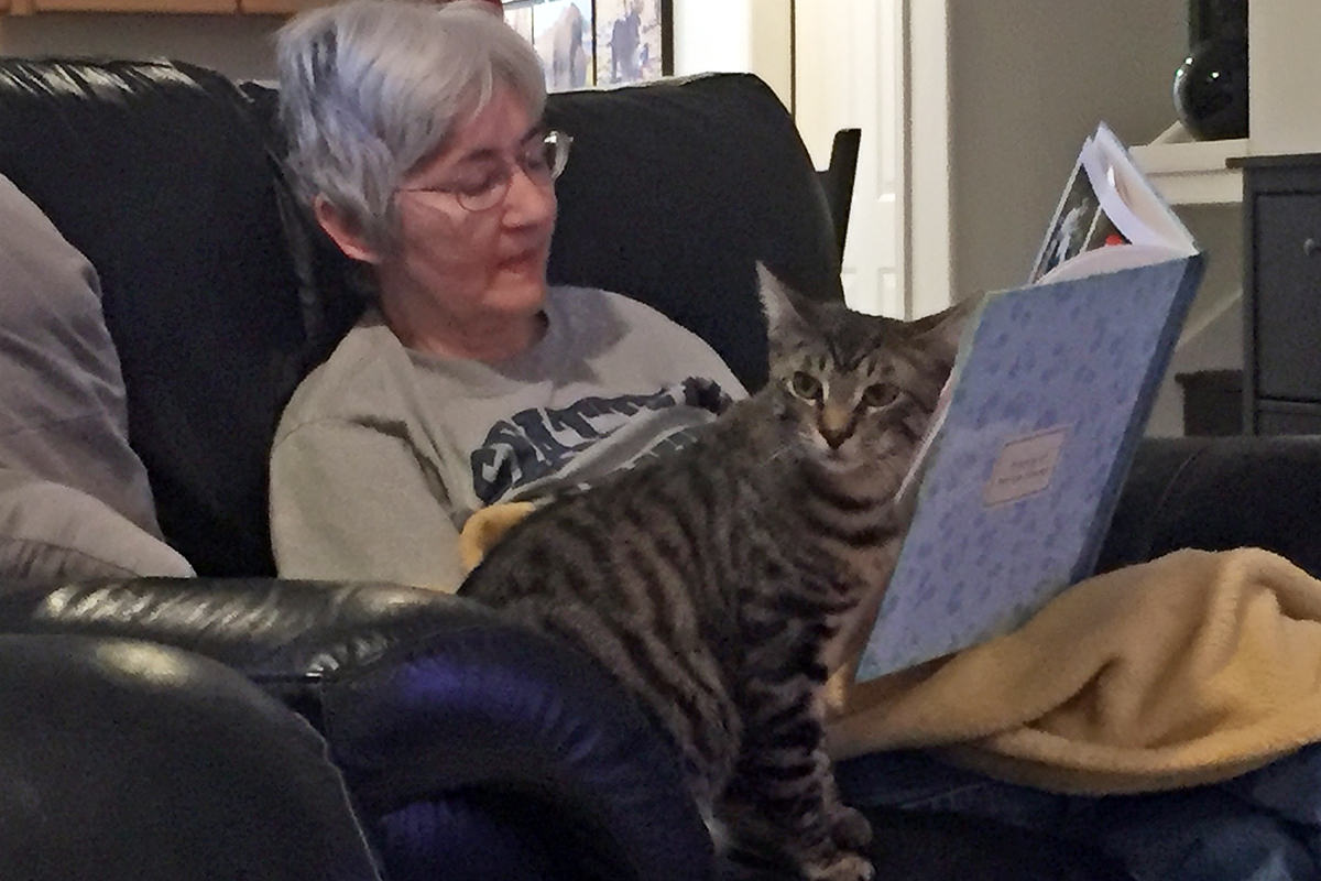Mom Reading Her Travel Book with Jake!