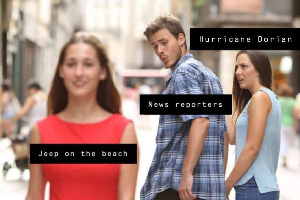 A guy labeled NEWS REPORTERS is ignoring a woman labeled HURRICANE DORIAN and staring at a pretty woman labeled JEEP ON THE BEACH as she walks by.
