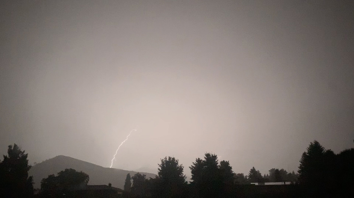 Lightning striking a nearby hillside.