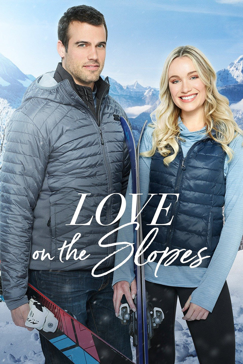 The movie poster for Love on the Slopes showing a pretty couple in winter clothing standing in front of a snow-covered mountain.