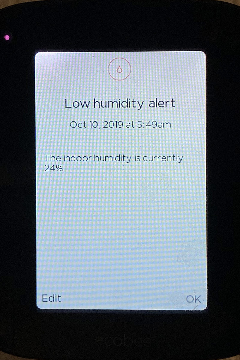 The display on my smart thermostat telling me that the indoor humidity is only 24%.
