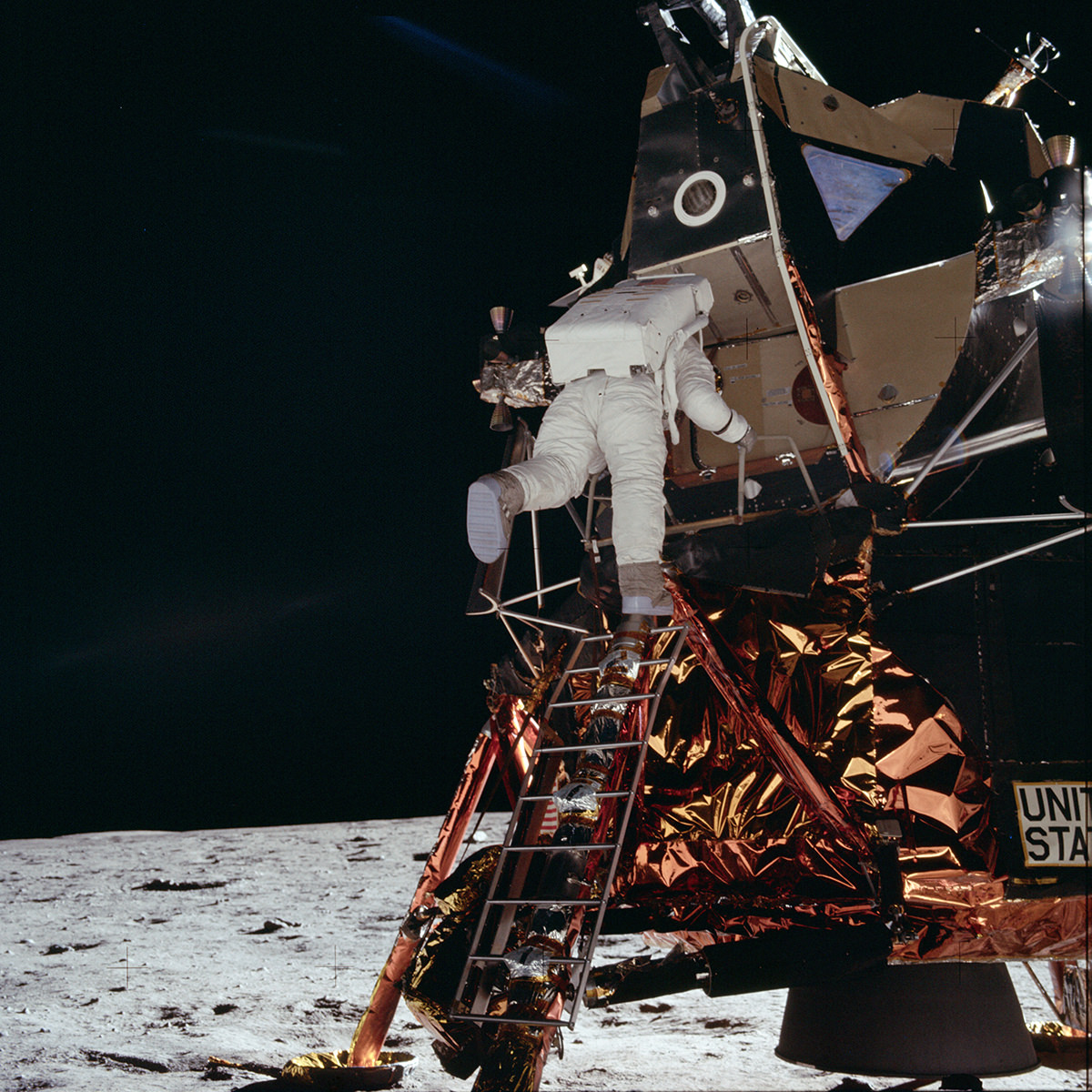 An astronaut descending from the lunar lander on the moon.