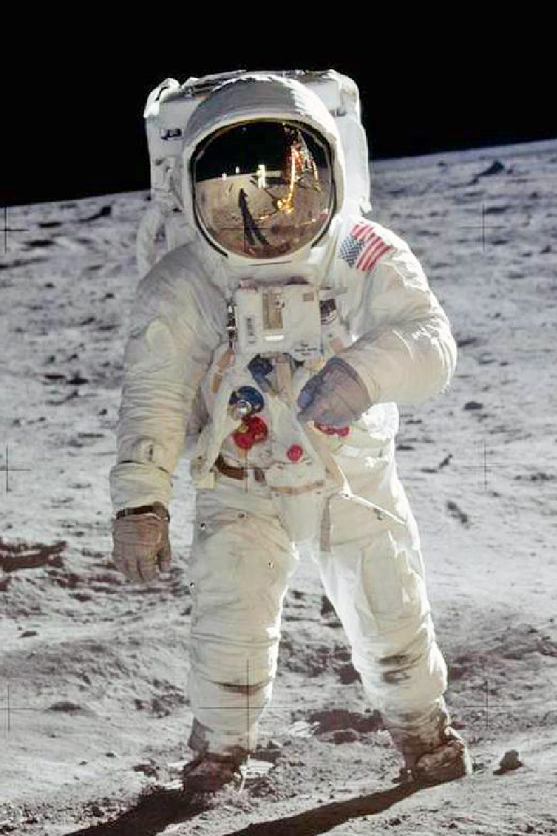 An Apollo astronaut on the moon.