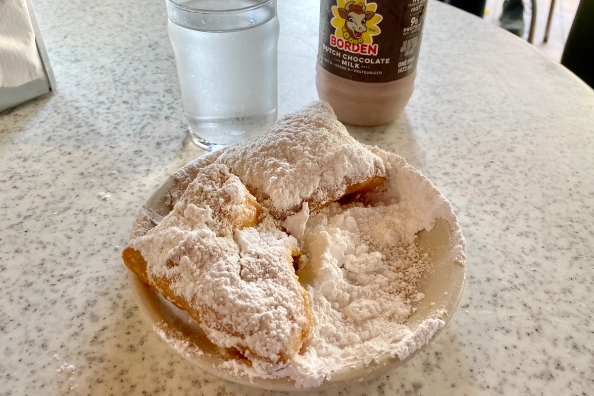 Beignets at Cafe du Monde, covered in entirely too much powdered sugar.