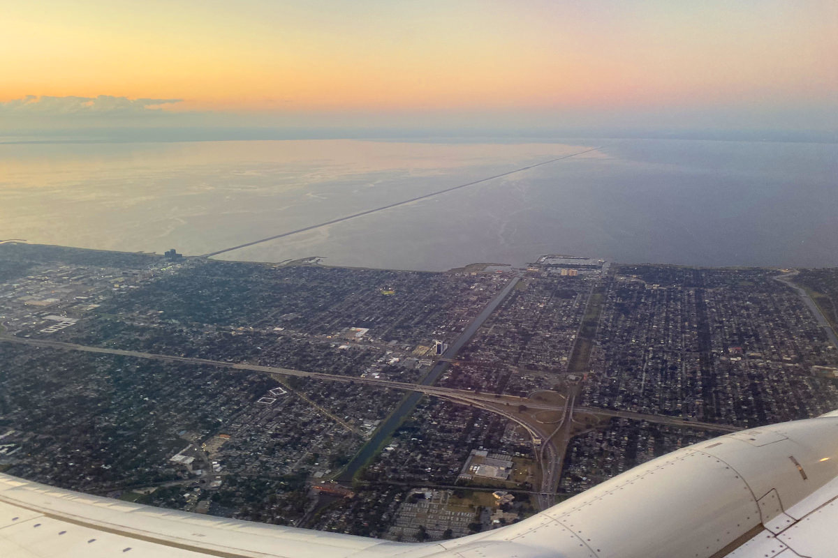 Looking out an airplane window at the bridge which spans Lake Pontchartrain.