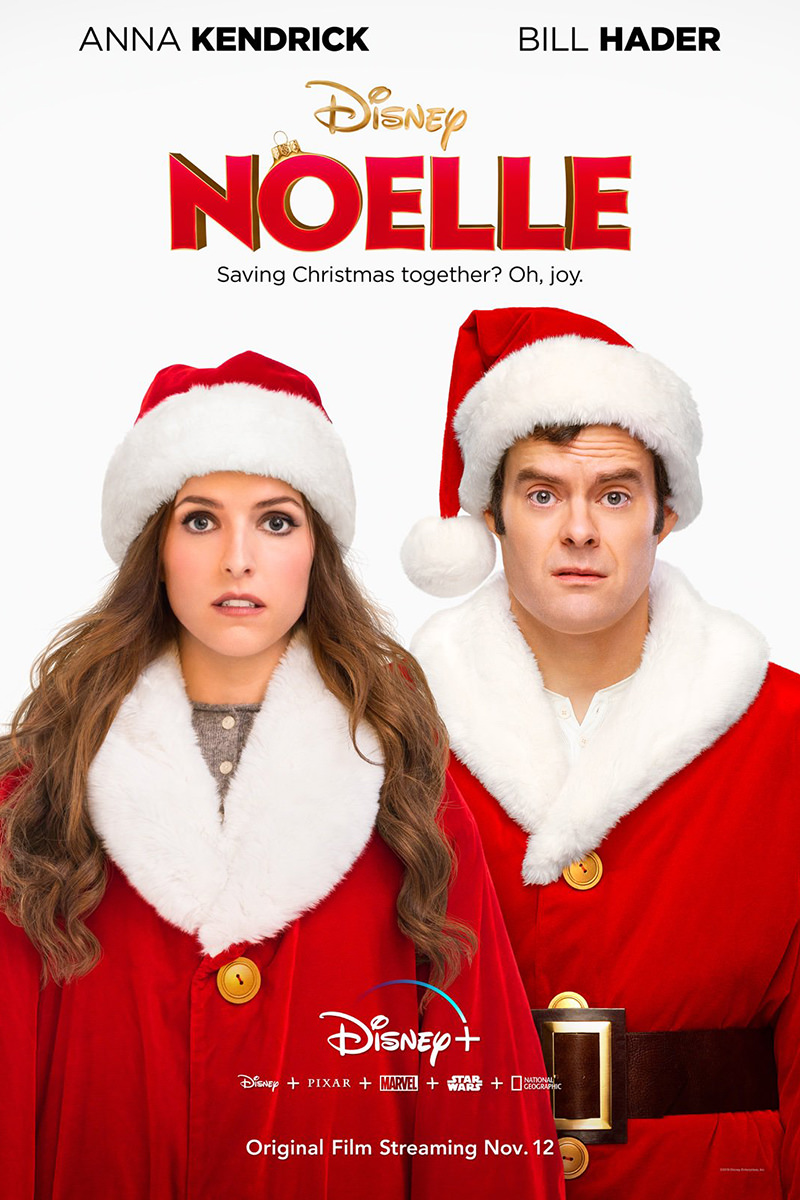 Anna Kendrick and Bill Hader dressed in Santa suits.