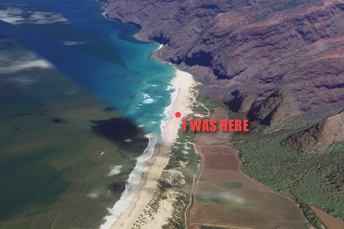 A satellite view looking down at Polihale Beach with pretty water and a looming cliff in the distance.