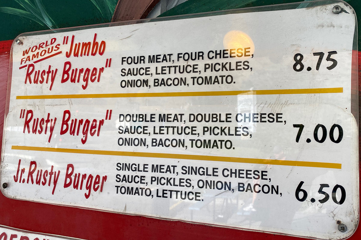 Jumbo Rusty Burger: Four meat, four cheese, sauce, lettuce, pickles, onion, bacon, tomato.