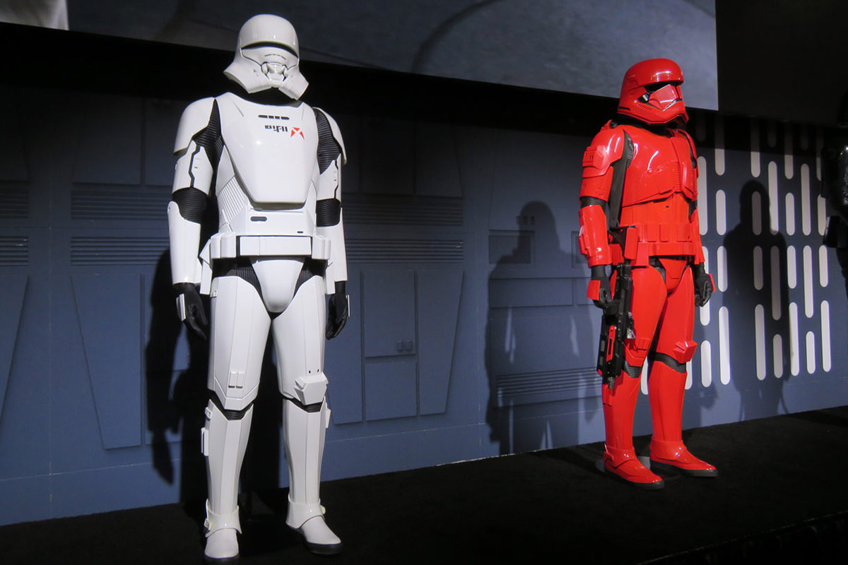 White Jet Trooper and red Sith Trooper armor on display.