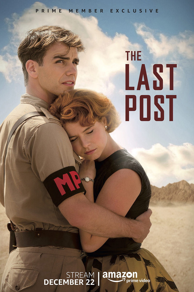 A poster for The Last Post showing a military police officer holding on to a beautiful woman in the dessert.