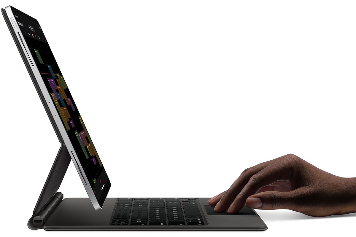 Apple's new Magic Keyboard with an iPad attached to it... when seen from the side everything is really thin.