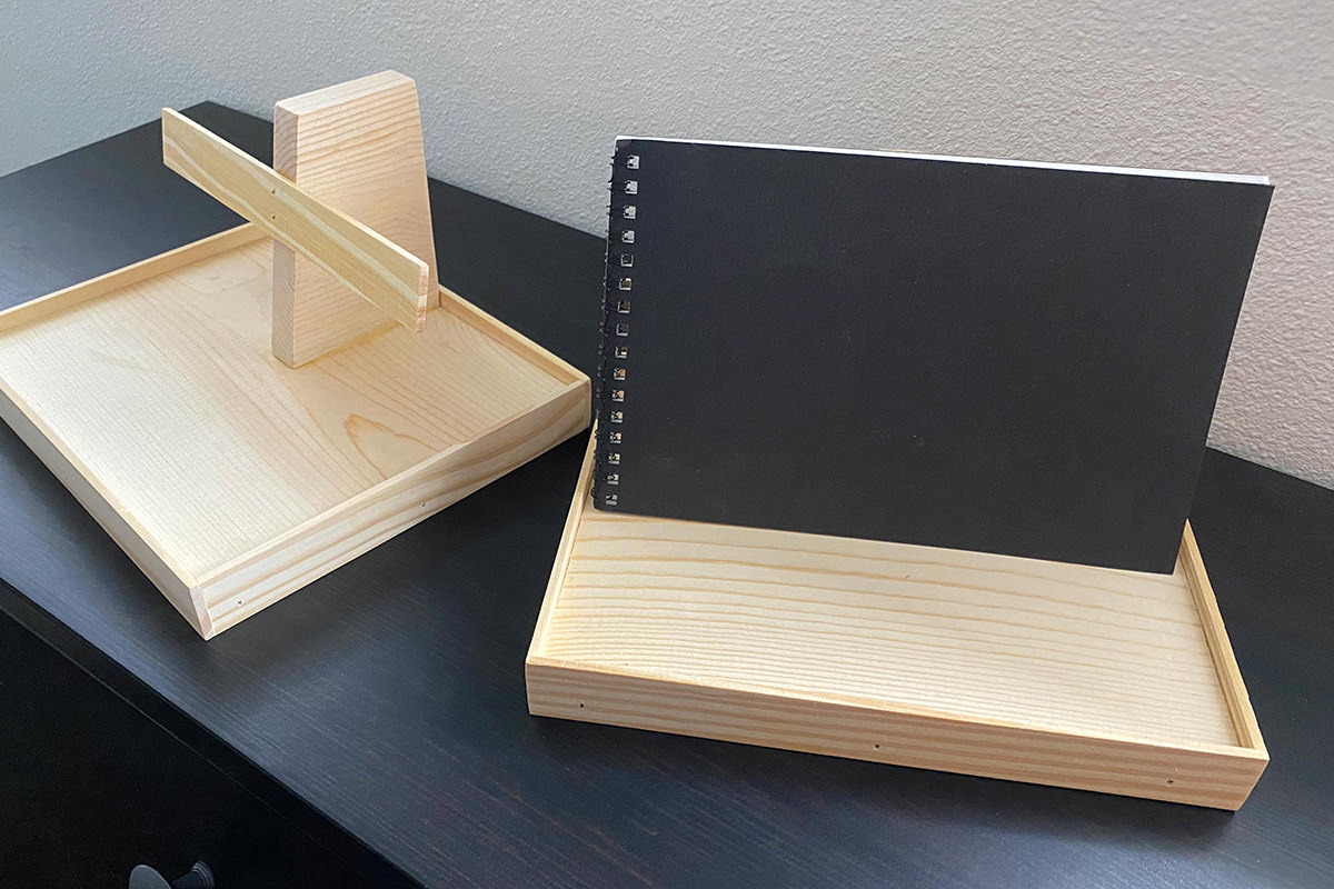Wooden display stands for small booklets.