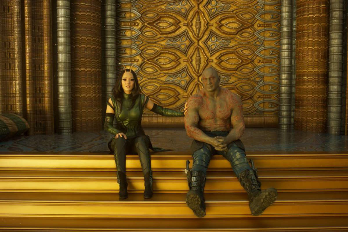 Drax and Mantis sitting on golden steps.