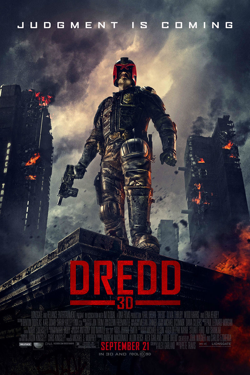 Dredd movie poster featuring Judge Dredd standing on top of a building while a city is errupting in destruction and flames.