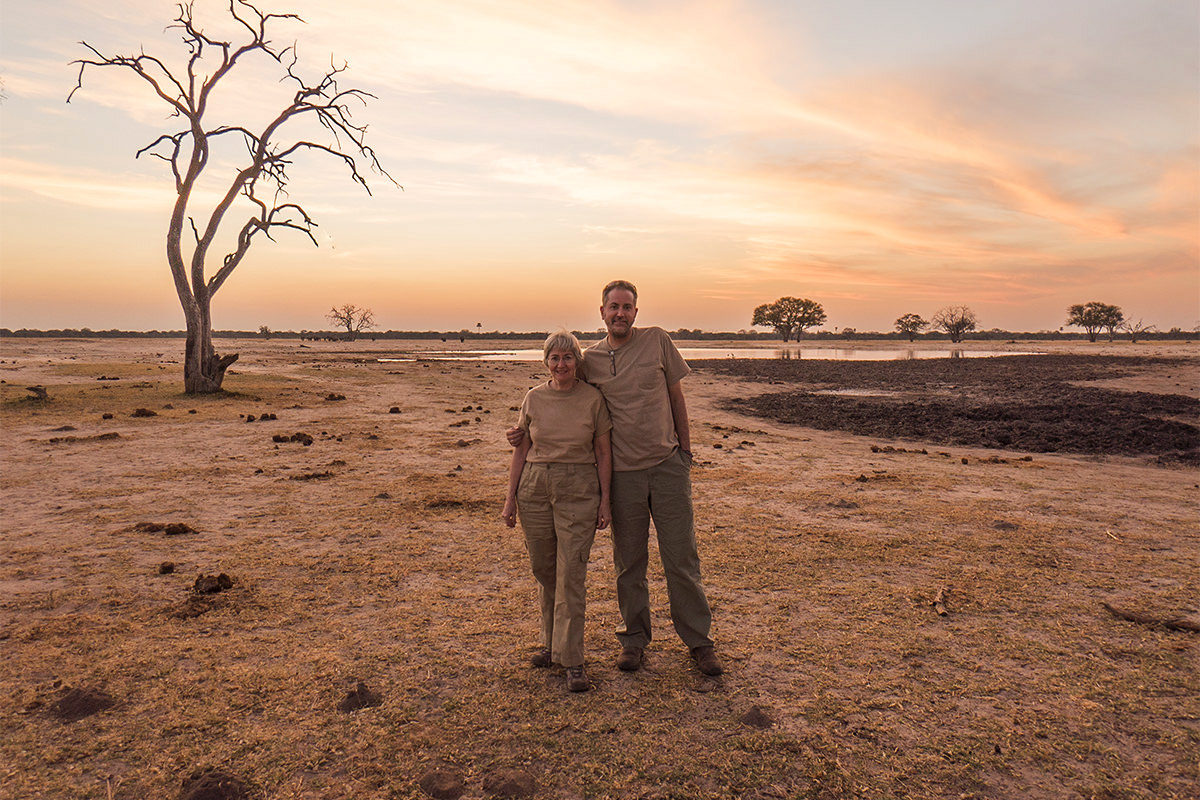 Mom and I standing under a gorgeous African sunset with the savannah in the background.