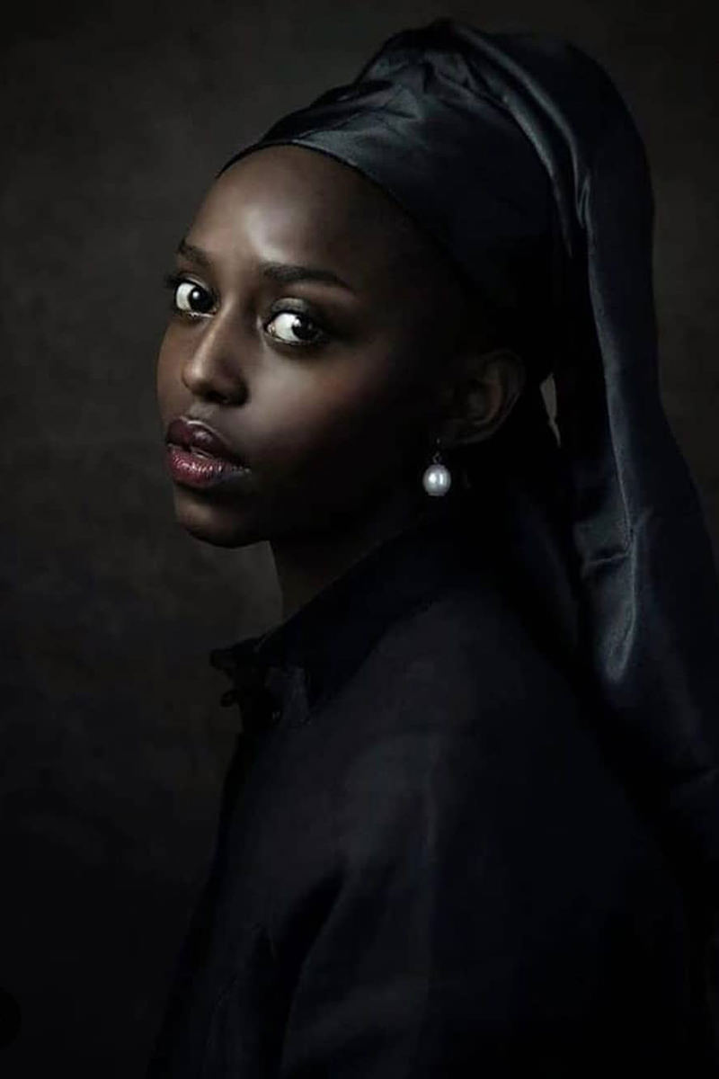 A Black woman reinacting the famous Vermeer painting Girl with a Pearl Earring.