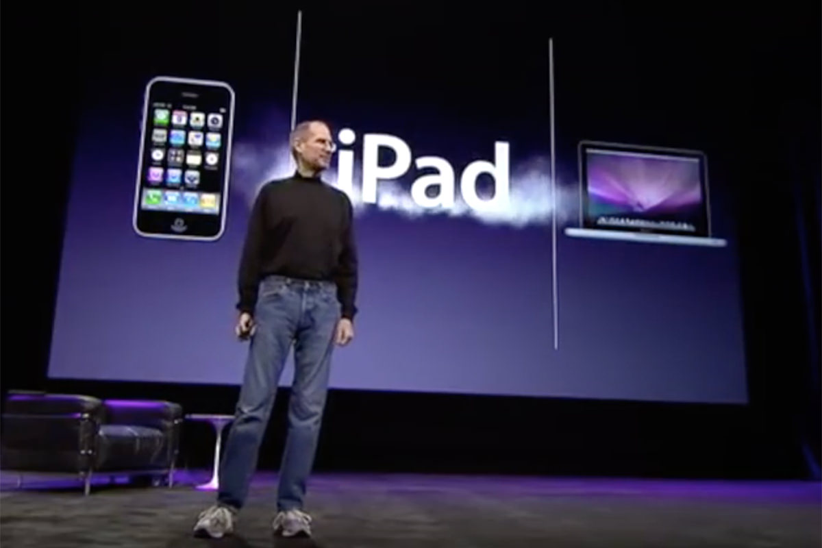 Steve Jobs unveiling the iPad at a computer event.