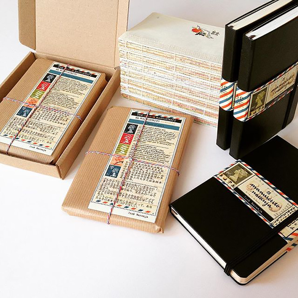 A photo of José Naranja journals with thick black covers and beautiful packaging.