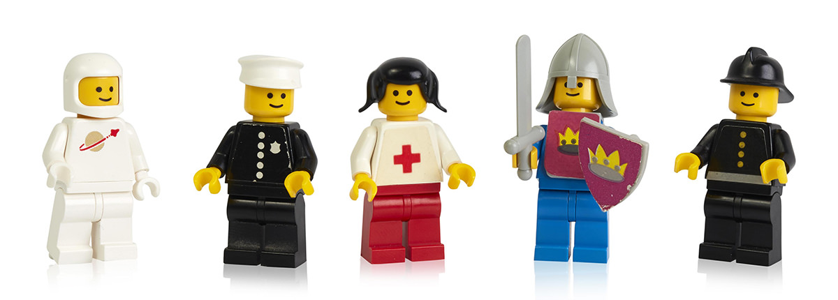 An assortment of LEGO minifigures lined up.