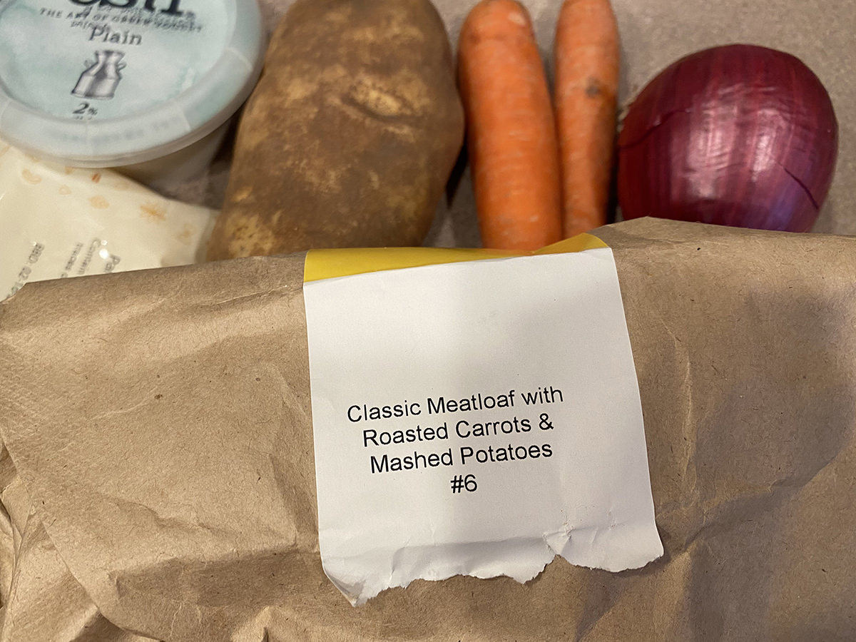 A label on an ingredients bag which says CLASSIC MEATLOAF WITH ROASTED CARROTS AND MASHED POTATOES.